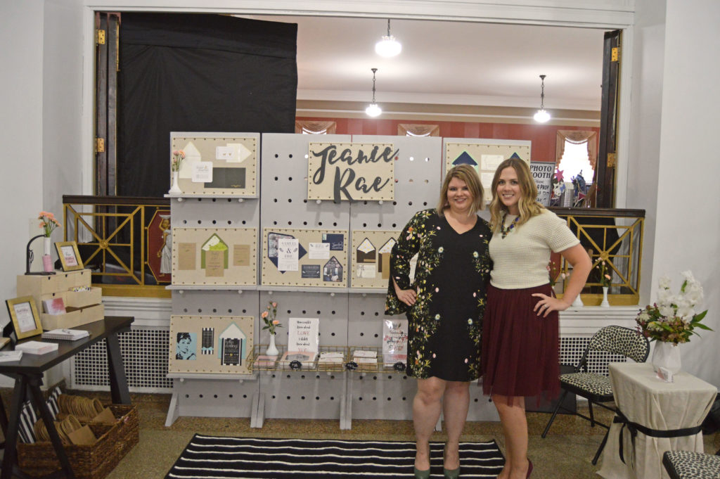 Ashley and Lyndsay in front of their display at the New Castle, PA I do wedding expo.